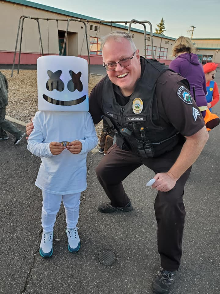 Police Officer with child in costume